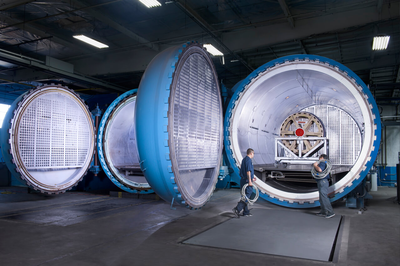 Technicians preparing autoclave for aerospace industry