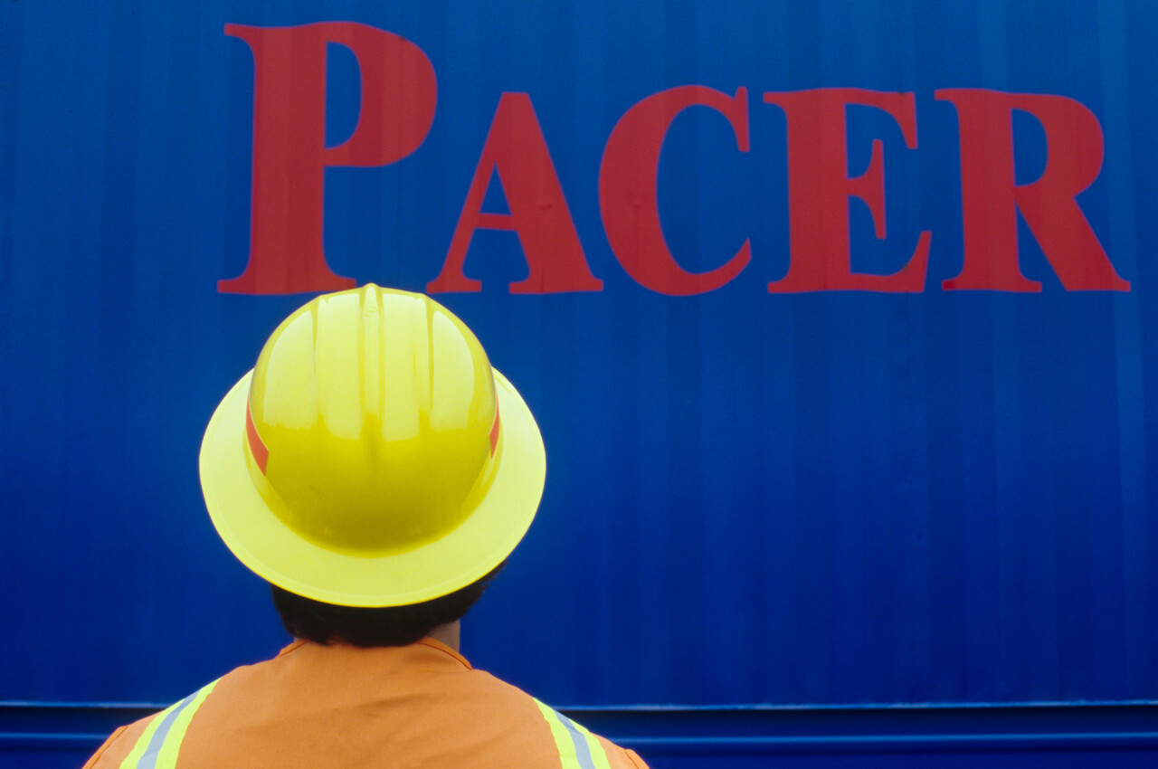 Pacer annual report. Worker at railroad yards.