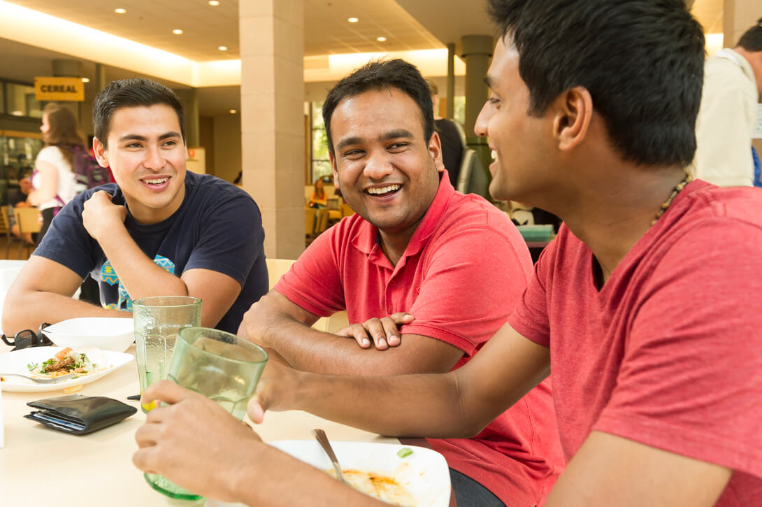 Lifestyle image of students socializing at cafeteria. Harvey Mudd College